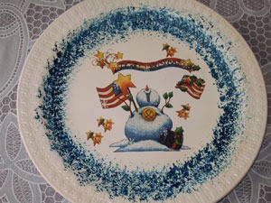 Plate decorated with a snowman transfer.