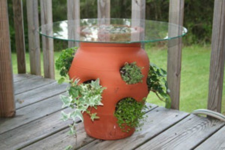 strawberry pot with a glass table top