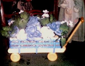 Floral arrangement in wagon.