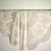 tablecloth on a curtain rod attached to the wall