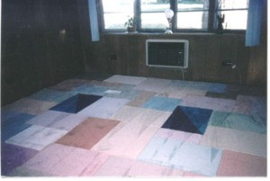 Floor carpeted with samples.