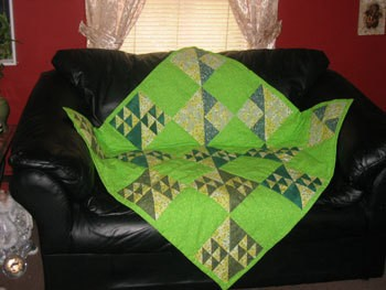 lime green flying geese baby quilt