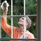 A man washing windows.