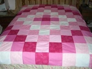 A homemade patchwork quilt topper
