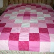 A homemade patchwork quilt topper