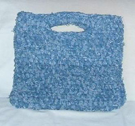 A crocheted rag bag made out of recycled denim jeans.