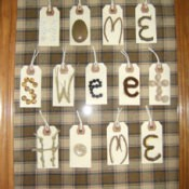 """A frame that says """"Home Sweet Home"""" on tags."""