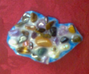 Stone and bead brooch.