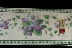 Border with purple flowers, maybe violets.