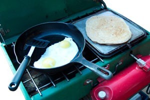food cooking on camp stove