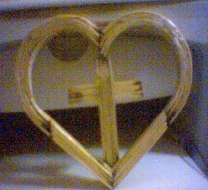 Heart with cross in center.