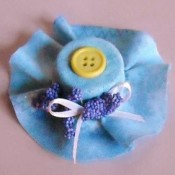 blue fabric covered cap in shape of bonnet