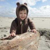 small boy crawling beach