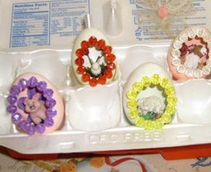 Several finished eggs in carton.