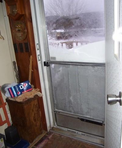 Screen door and snow.
