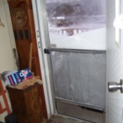 Screen door and snow.