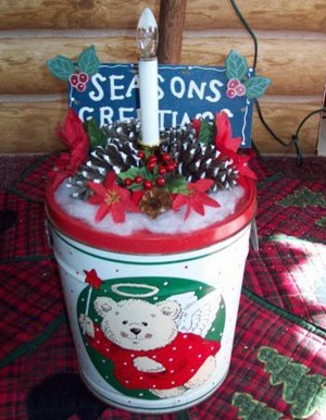 A decorative lighted welcome tin made from a recycled popcorn tin.