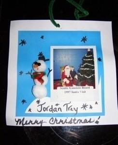 Photo on blue background with pom pom snowman.