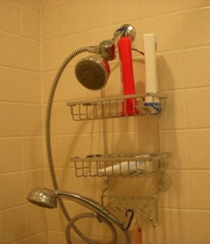 Using a thick rubber band to keep shower rack from sliding down the shower head.