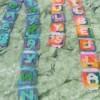 Plastic canvas letter ribbons.