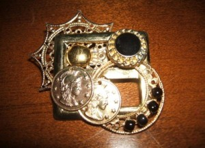 A brooch made from recycled jewelry pieces.