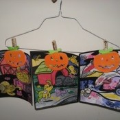 kids artwork on clothing hanger