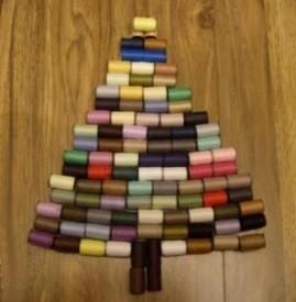 Making a Thread Spool Christmas Tree - small spools of thread used to make a tree shape