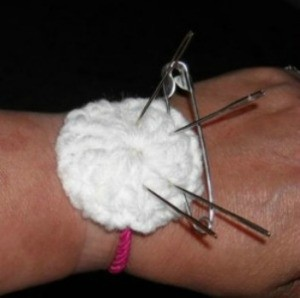 Finished pin cushion on makers wrist.