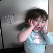 Child by fridge.