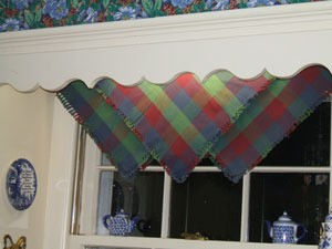 Three napkins hung on the point over the curtain rod.