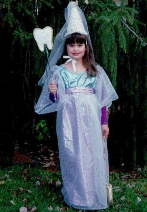 young girl dressed as tooth fairy