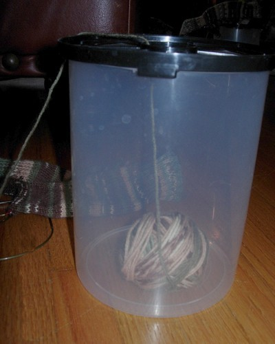 Side view of yarn ball in container.