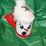 blown away snowman gift can
