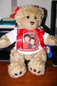A build a bear stuffed animal with a photo T-shirt.