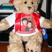 A build a bear stuffed animal with a photo T-shirt.