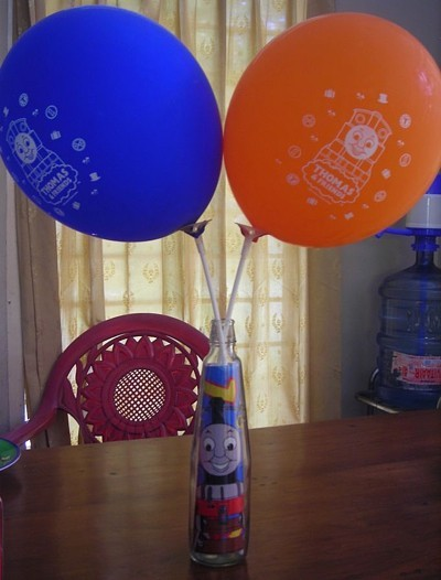 bottle picture of Thomas the Train inside and two balloons