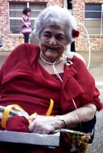 Elderly woman in red