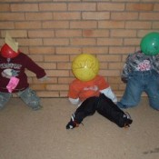Scarecrows made with toddler clothing and balloon heads.