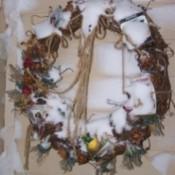 Snow on door wreath.
