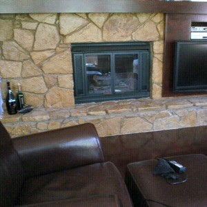 Rock Fireplace with a recliner in front