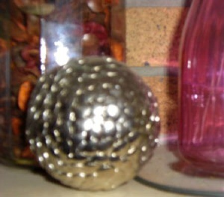 A decorative orb made form thumbtacks.