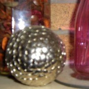 A decorative orb made form thumbtacks.