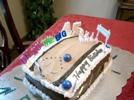 A birthday cake that resembles a bowling alley.