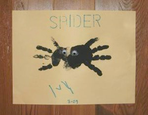 A handprint spider on a piece of paper.
