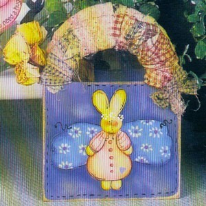 Fabric wrapped handle on small wooden box with rabbit motif.