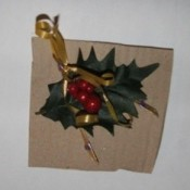 Christmas ornament made from painted wishbone and holly.