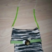 Small knit bag with strap.