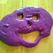 homemade purple silly putty in face shape