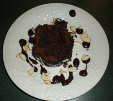A slice of Holiday Kahlua cake on a white plate.