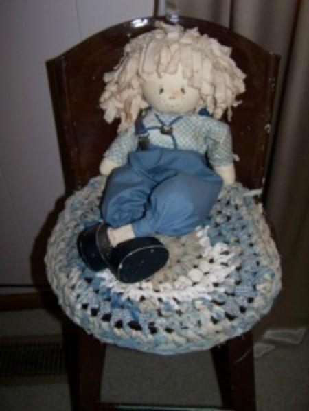 Crochet rag seat cover.